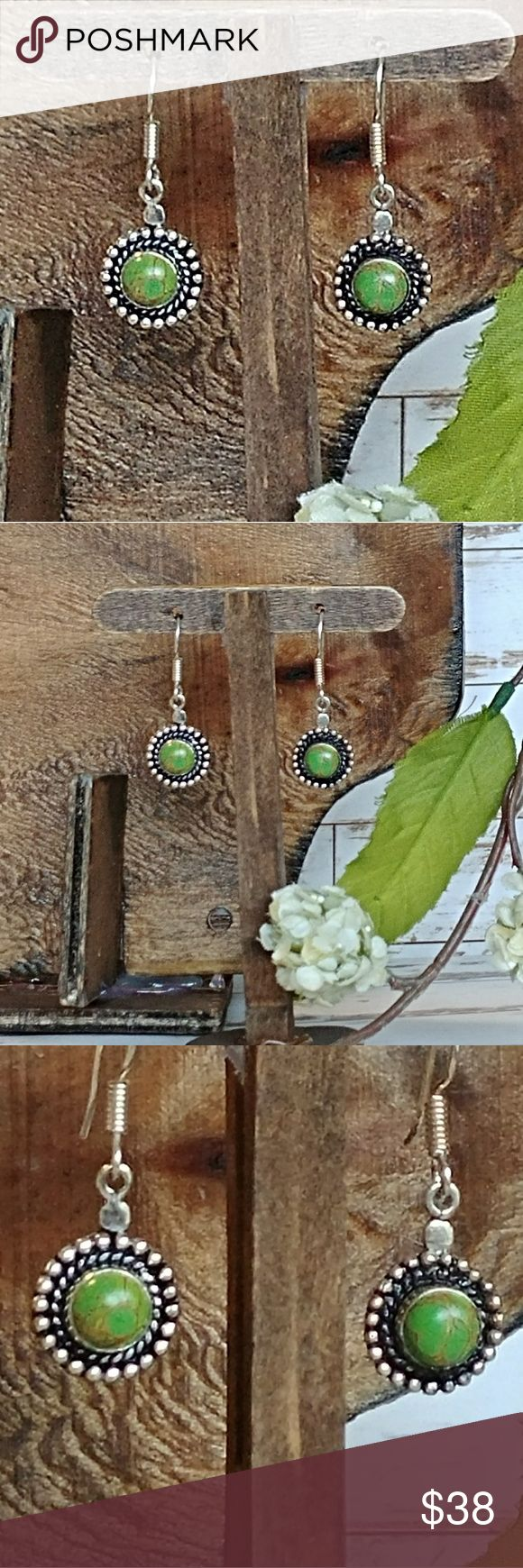 Green Copper Turquoise Antiqued Earrings Beautiful lime and apple greens mingle with flecks of gold in these unique Green Copper Turquoise stones. Set in solid sterling silver earring settings with black antiques accents. These are a great size for everyday wear at about 12mm diameter.  Jewelers retail: $286.00 Jewelry Earrings