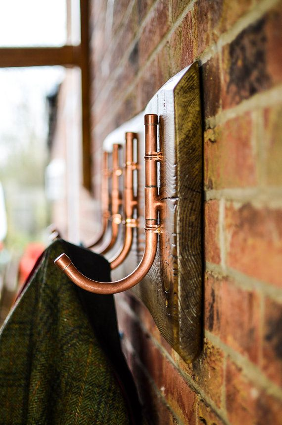 This industrial-chic coat rack is handmade from a reclaimed slab of lumber and 15mm copper pipe which was salvaged from a plumbing job. Perfect for hanging your…