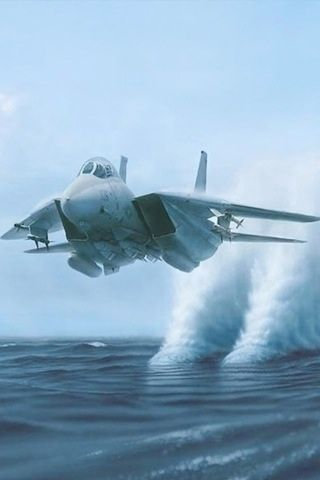 F14 Tomcat (water is pulled up after the engine intakes pass by). No actual vapour cone.                                                                                                                                                                                 More