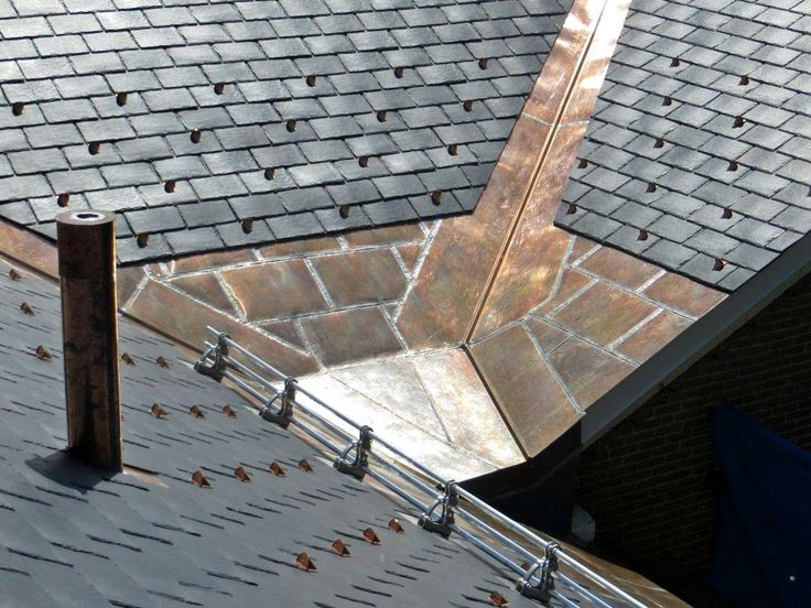 Three Pipe Height Adjustable Snow Guard System, And Pad Style Snow Guards  Shown In Copper. Photo Courtesy Of The Melanson Roofing Company, Keene, ...