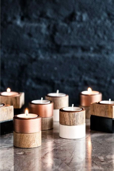 mix of black, white, copper and wood tea light holders