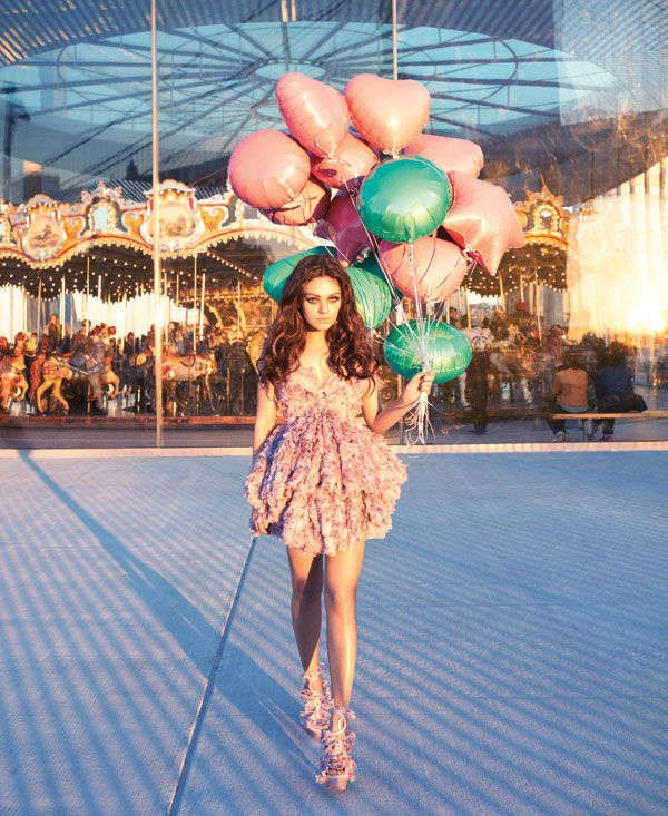 Harpers Bazaar April 2012 - Actress Mila Kunis stars in a playful kitschy cover shoot for the Harper's Bazaar April 2012 issue that pictures the stunning actress in bubbl...