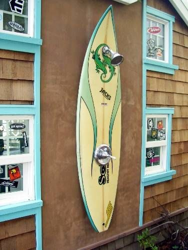 Surfboard shower - how fun is this for your outdoor beach shower? The kids will be fighting over time to use this. Great way to bring the beach poolside, too.