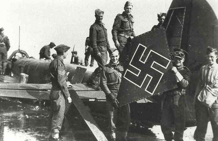 """When originally published, the photograph by Frank Lalouette of Bognor Regis was captioned Wrecking the Wreckers, showing soldiers removing the port panel from the tail fin of Ju88A-1 4D+AD of Stab 3/KG30 as a trophy. S/L Alexander VR """"Sandy"""" Johnstone, P/O Archibald """"Pat"""" Lyall and F/O Paul C Webb of No 602 Squadron RAF had disabled the starboard engine and holed both radiators 20m north of Mayfield at 17.40 on 9 September 1940, before the bomber force-landed on the banks of Pagham Harbour."""
