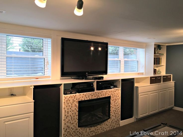 Built-ins with fireplace and windows.