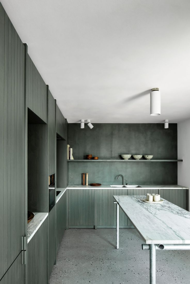 Apartment on the Belgian coast balances natural and industrial materials