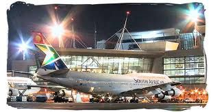 A plane taking its passengers-in at the Johannesburg Airport, South Africa.