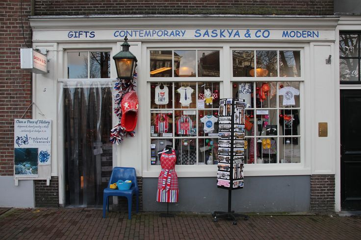 """*SASKYA & CO CONTEMPORARY SOUVERNIRS Our shop-philosophy is to profide high quality and long lasting items. 'Made in Holland'- local made, not mass production from China. Since 2005 this modern gift shop is situated on the right side of the Renaissance Hotel, corner Singel canal, next to the """"Koepelkerk"""". http://www.saskyasouvenirs.nl"""