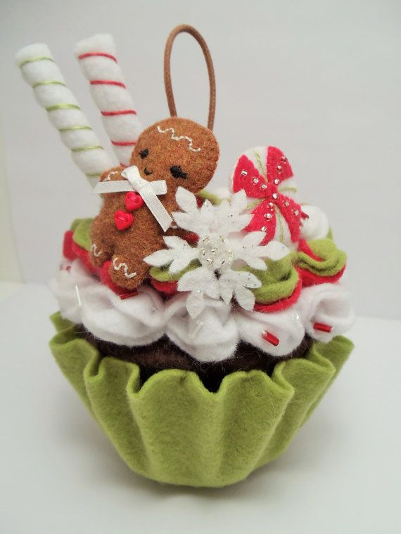 This Christmas cupcake ornament features red, green, and white frosting