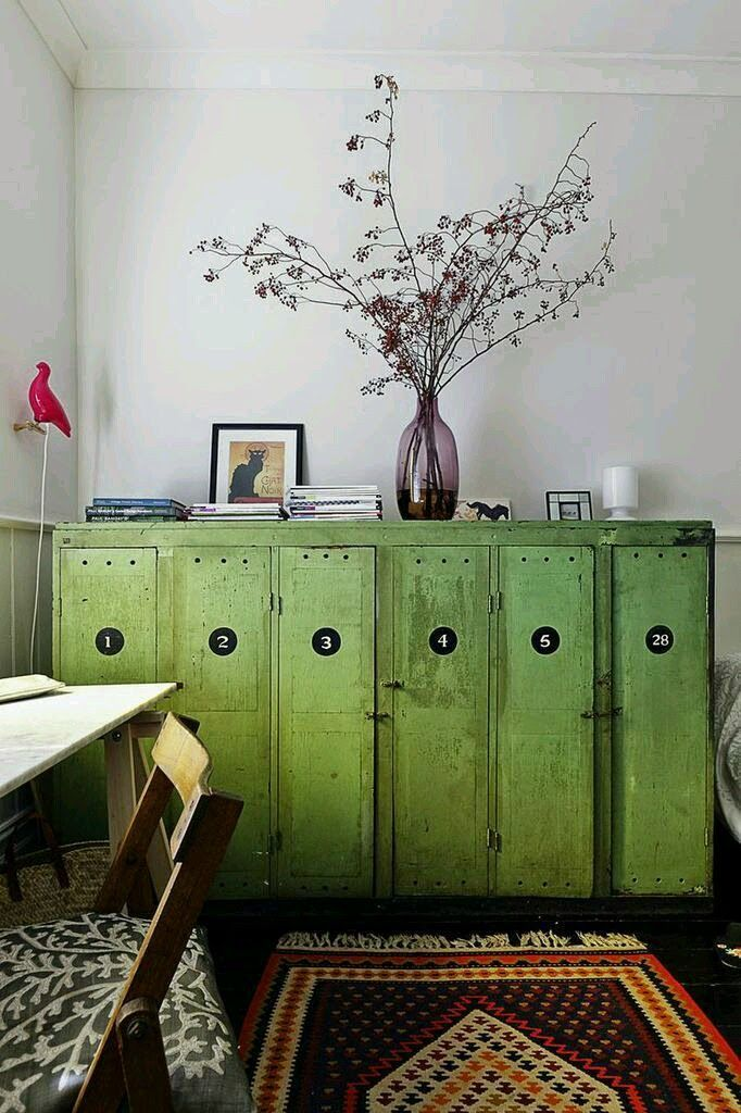 These look like some sort of lockers that have been transformed into a show-stopping sideboard. Love the the bright yellow green paint color and the large circular numbers on the separate panels.