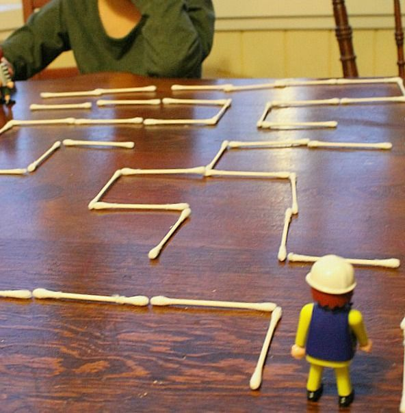 A q-tip maze! Such a great quiet time activity for preschoolers. Develops spatial skills, math skills, and fine motor skills too!