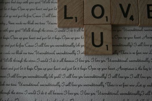 """""""Love You"""" Scrabble Tile Display.  This is super cute, and really sweet with the lyrics of our song on the background."""