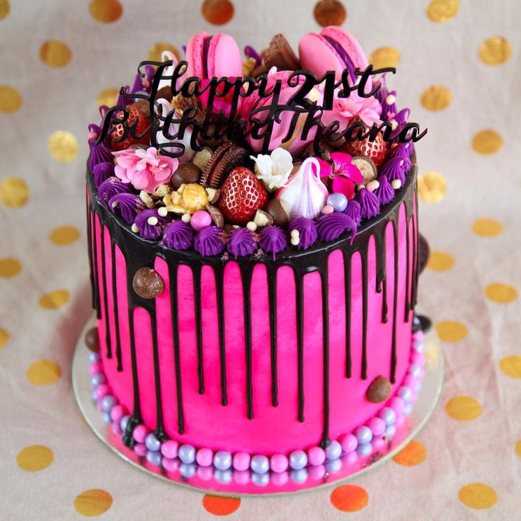 "Here it is! In all its bright and vibrant glory! So much visual overload. I hope your birthday has been amazing Theana! Four layers of alternating milk chocolate and vanilla cake, covered and filled with hot pink Nutella buttercream, milk chocolate drop, luster dusted strawberries, pink and purple meringues and macaroons, popcorn, Oreos, maltesers and the most beautiful hot pink edible flowers! All topped with a custom designed ""Happy 21st Birthday Theana"" topper in black!"