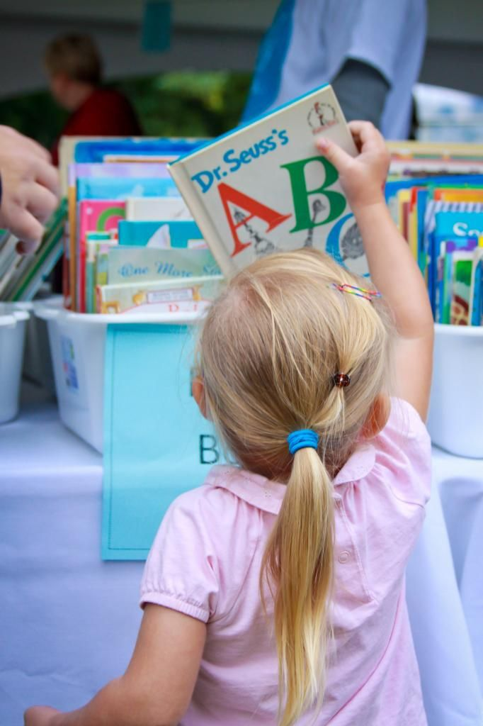 A child selecting a book at the Telling Tales Festival