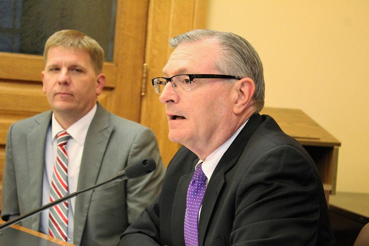 Raney Gilliland, right, director of the Kansas Legislative Research Department, and Shawn Sullivan, Gov. Sam Brownback's budget director, brief the Statehouse media Thursday on the state's updated revenue projections.
