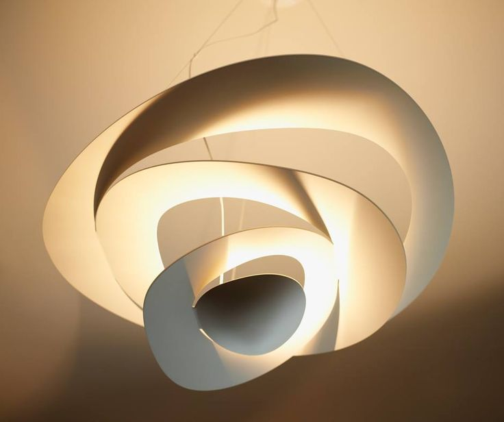 From a thin ceiling plate, gently descending waving spirals create enchanting effects of form and light: #Pirce suspension ► http://bit.ly/1fmHduS #design Giuseppe Maurizio Scutellà Hotel Le Germain Maple Leaf Square, Toronto | © Groupe Germain Hospitalité