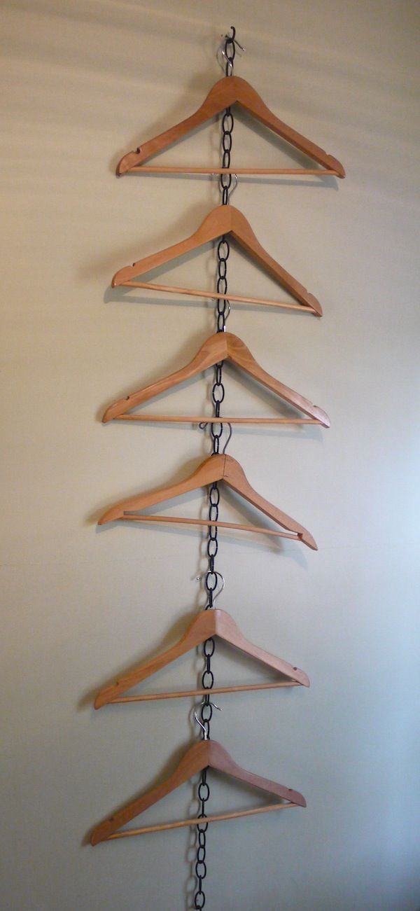 Cottage living: How to hang clothes when there's no closet. @learningandyearning Nice for hanging clothes at display Go Up and Down for more space saving ...