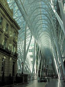 """Brookfield Place, the Allen Lambert Galleria - contains """"the Merchants Bank Building, which has been encased in modern steel and glass to spectacular effect."""""""