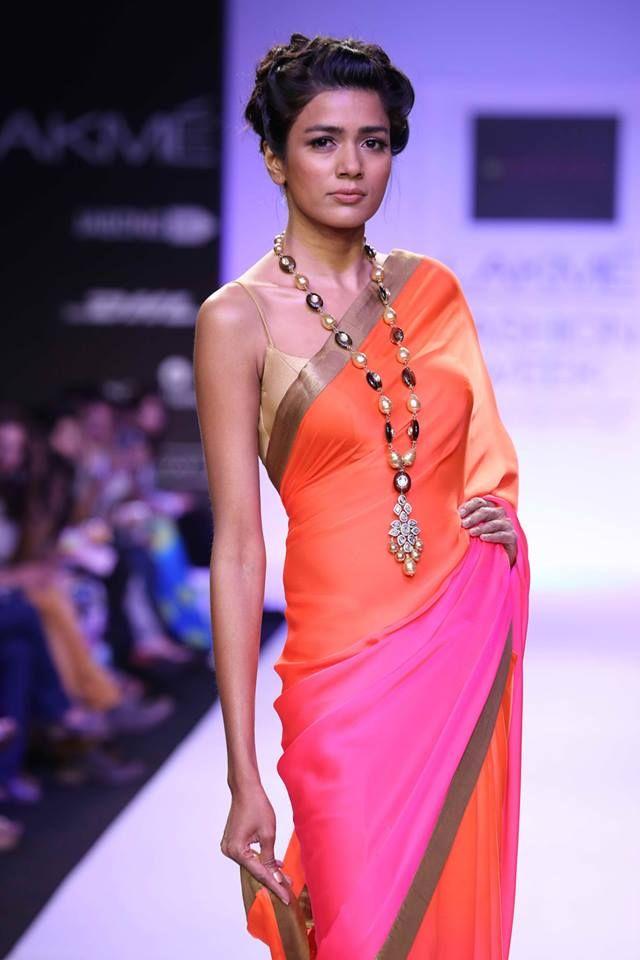 Mandira Bedi Lakme Fashion Week Summer 2014 color blocked pink and orange sari. More here: http://www.indianweddingsite.com/mandira-bedi-lakme-fashion-week-summer-resort-2014/