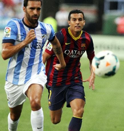 F.C. Barcelona's Pedro Rodrguez, right, vies for the ball with Malaga's Jesus Gamez, left, during a Spanish La Liga soccer match at La Rosaleda stadium in Malaga, Spain, Sunday, Aug. 25, 2013