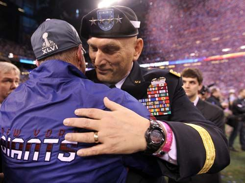 New York Giants coach Tom Coughlin hugs Army Chief of Staff Gen. Ray Odierno after defeating the New England Patriots in Super Bowl XLVI.