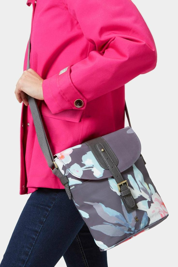 Keep your hands free and your belongings safe with this coated cotton canvas purse. Designed to be worn across the body with internal zip and phone pockets as well as popper pockets to the front and back. Wipe clean with a damp cloth.    Shoulder strap  Flap over top  Zip fastening  Slip in back pocket  Internal zipped pocket  Hand-drawn printed lining Cross Body Purse by Joules. Bags - Cross Body Wisconsin