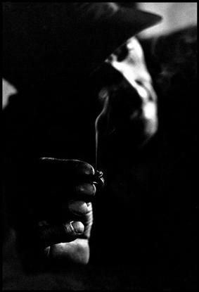 Constantine Manos.   USA. 1961. West Virginia. In the mine fields of West Virginia unemployed miners roll their own cigarettes.