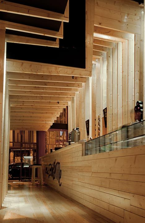 « Older story Newer story »  La Bohème by AVA Architects  3 March 2012                Ribbed timber framework folds around the walls and ceiling of this bar in Porto by Portuguese studio AVA Architects (photos by José Campos).