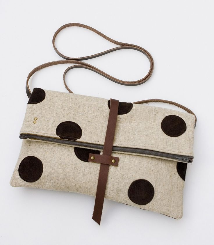 Foldover crossbody bag with hand cut leather polka dots.