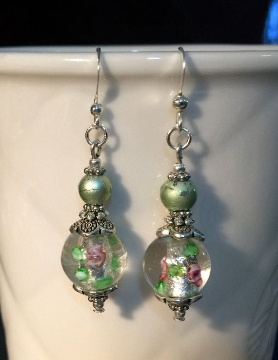 Vintage style dangle earrings with glass lampwork beads in silver green and pink tones. $9