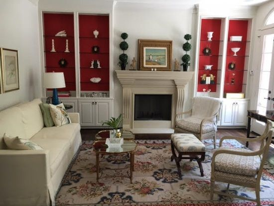 Needlepoint Rug Living Room With Red Bookcases Houston