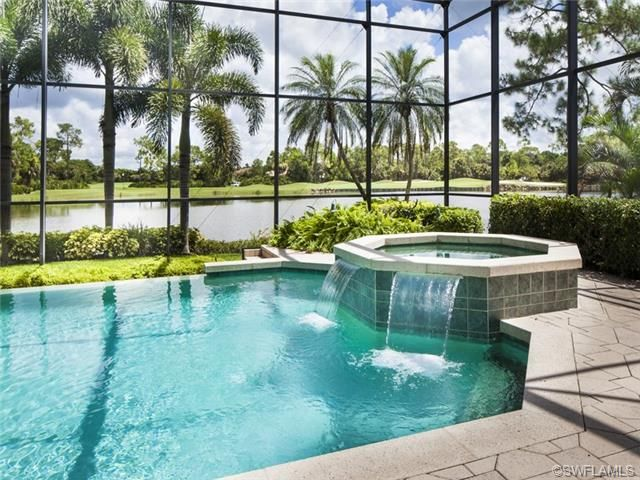 Pool And Spa With Water Feature Under Screened Lanai