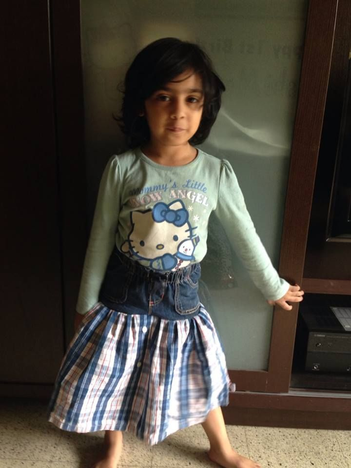 Santoshi wearing the skirt, paired with a Hello Kitty t-shirt