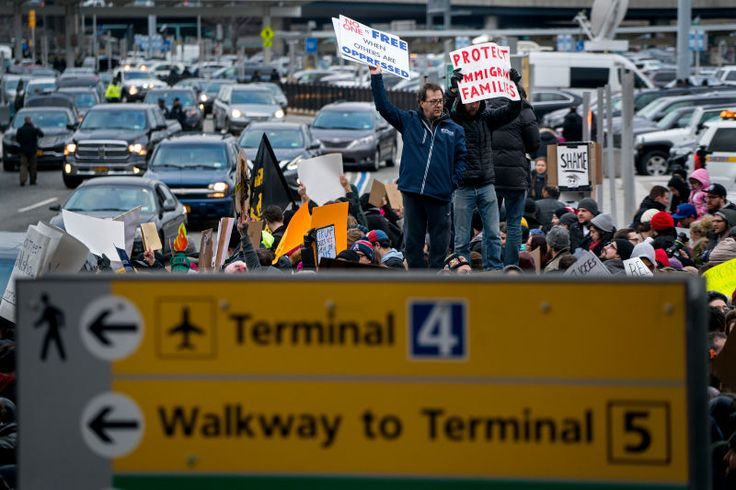 The New York Taxi Workers Alliance has announced on Twitter that it is halting passenger pickups at JFK airport in protest of the dozens of people detained under President Trump's Muslim immigration ban.