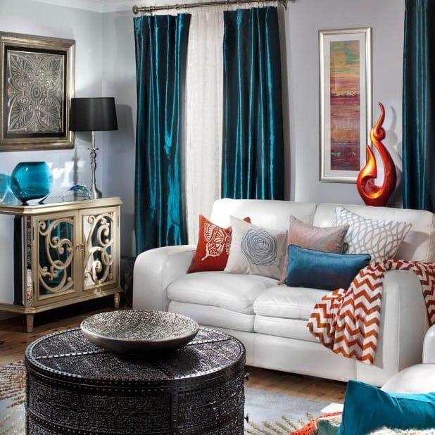 سحر اللون الأزرق الفيروزي بدرجات ثقيلة تجعله ينبض بالفخامة في ديكور المنزل ديكورات أرا Living Room Colors Victorian Living Room Decor Grey Curtains Living Room