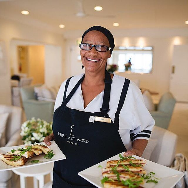 The lovely Joan serving a delicious lunch to guests on the balcony. Enjoy a superb lunch over looking the ocean, or arrange for a candle light dinner during your next visit to The Last Word Intimate Hotels - beyond boutique.