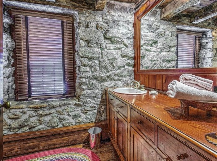 Bath With Stone Walls And Wood Cabinetry From A 1730 Historic Stone Cottage  Featured On Between Good Looking