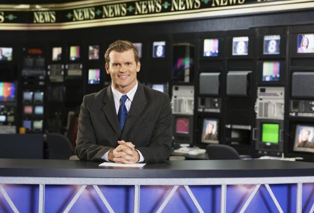 Learn About Being a News Anchor: A news anchor at the desk.