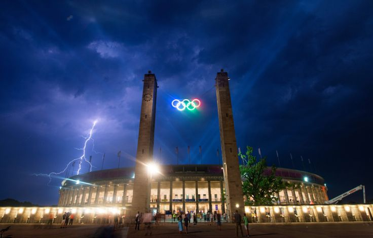 Lightning strikes above the the Olympic stadium during a concert by German singer Helene Fischer in Berlin
