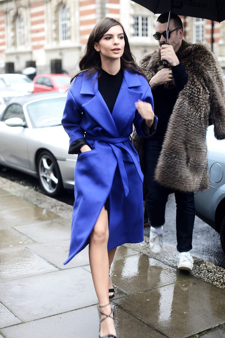 Emily Ratajkowski in a royal blue trench coat