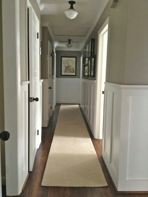 Wainscotting can make a boring hallway feel upscale and distinctively designed.