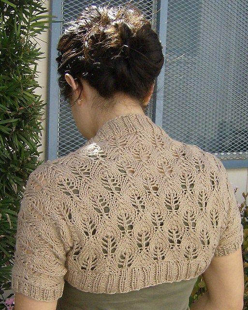 Free knitting pattern for Something Lacy Shrug, easy candle flame lace shrug pattern