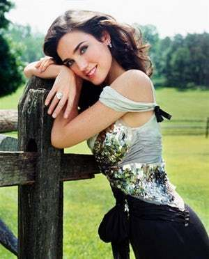 Leaning against a rustic fence is listed (or ranked) 4 on the list The Hottest Jennifer Connelly Pics