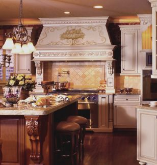 A Unique, Hand Painted Custom Range Hood Takes Center Stage In This Kitchen  Featuring White French Provincial Mouser Custom Cabinetry.