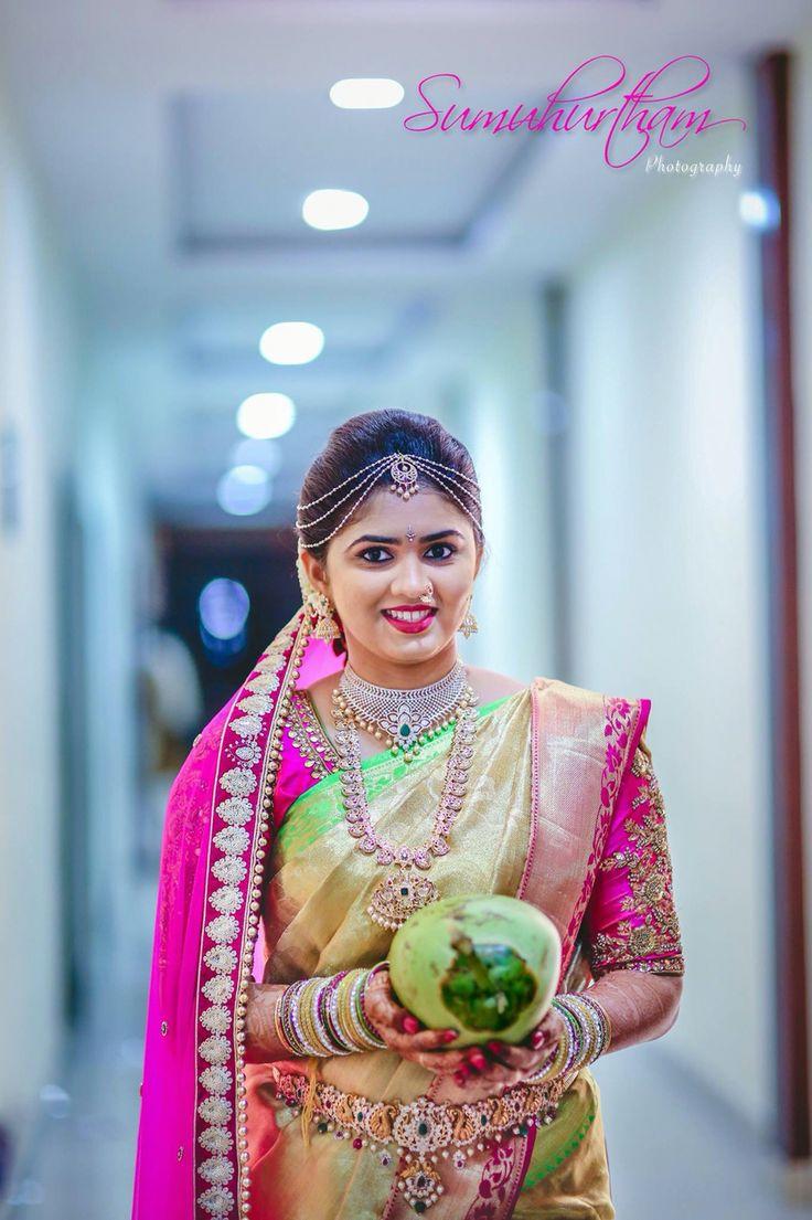 South Indian bride. Diamond Indian bridal jewelry. Temple jewelry.Jhumkis.Pink and cream Kanchipuram silk saree.Braid with fresh flowers. Tamil bride. Telugu bride. Kannada bride. Hindu bride. Malayalee bride.Kerala bride.South Indian wedding.