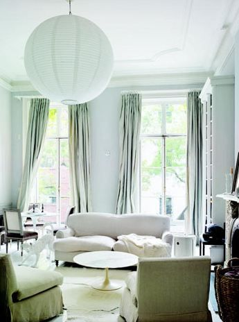 Love this mint colored living room.  High ceilings. Oversized large pendant light.  Cool calming.