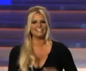 """Jessica Simpson, member of jury Fashion Star TV show, shows her brests.Thirty two year old actress and singer, who is three months pregnant, appeared with big hair, but everything else was in the shadow of her cleavage.In the TV show """"Fashion star"""" girls learn how to become fashion icons, and Jessica with no doubt, shows them how to attract a"""