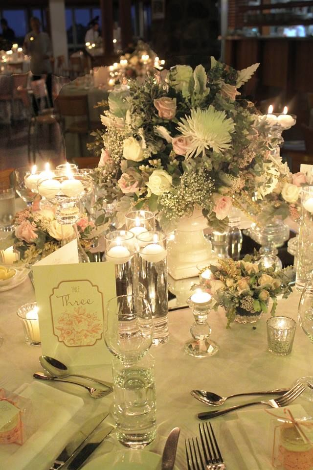 MW used various types of candle holders to create dimension on the tables and to illuminate the florals where ever possible