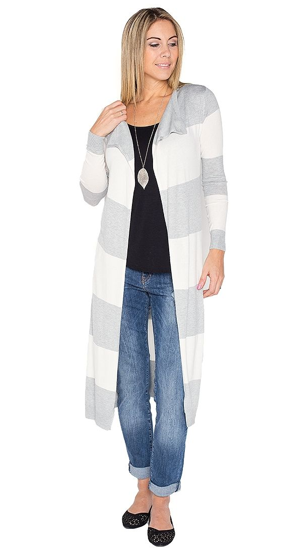 """Melrose Stripe Cardi - grey and ivory. Whether you are strolling down Melrose or your local farmer's market, this cardi will keep your look effortlessly chic. The Melrose Stripe Cardi features an open front and subtle ivory and grey stripes. We love its lightweight knit and maxi length with denim and ankle boots.  Model is wearing S Long sleeve Open cardi Length approx 46"""" 80% Viscose 20% Nylon"""