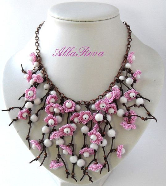 Necklace: metal chain, leather (?) straps, pearls and crochet